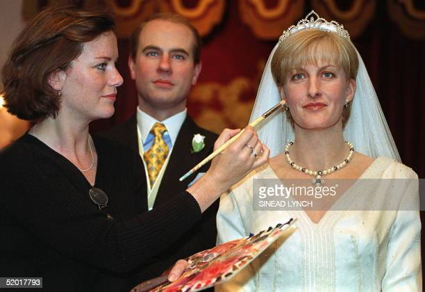 Madam Tussauds employee applies the finishing touches 20 June 1999 to a waxwork of the newlywed royal couple Prince Edward and Sophie RhysJones a day...