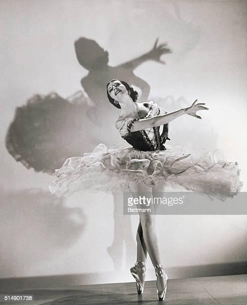 Madame Alicia Markova , famed English ballerina, tutu atwirl and en pointe, circa 1935.