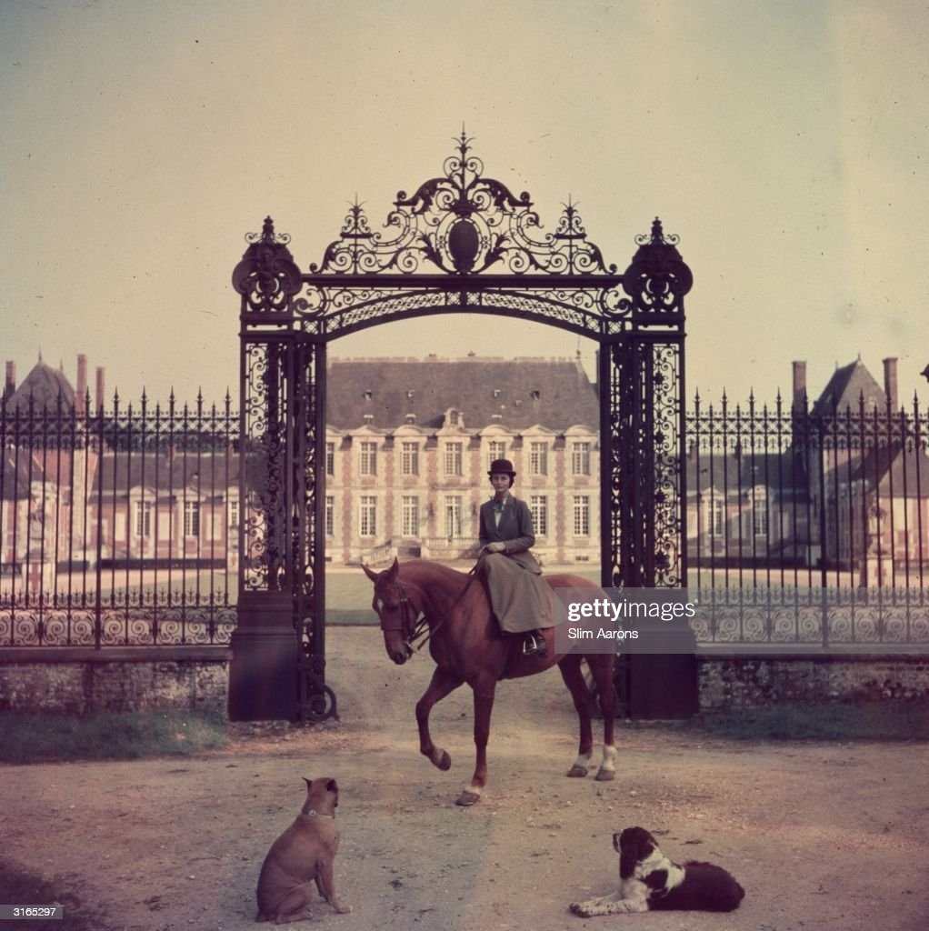 Madame de la Haye-Jousselin on her horse at the gates to her chateau in Normandy.