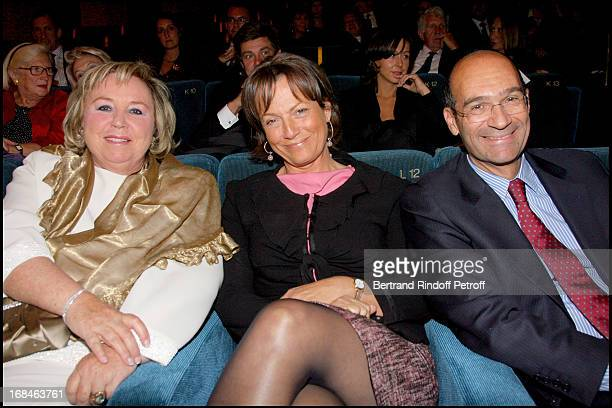 Madame Francois Pinault Eric Woerth and his wife at Premiere Of Film 'Faubourg 36' At Ugc Normandie In Benefit Of Claude Pompidou Foundation