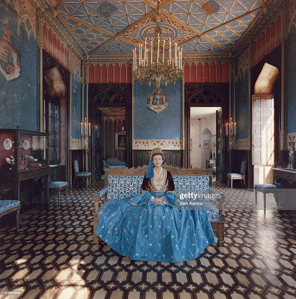Madame Jean Serpieri sits in the ballroom of the Tour La Reine near Athens, wearing a gown which belonged to the wife of Otto, the first king of modern Greece, December 1961. The palace too originally belonged to King Otto, and was used as a summer home by the royal family.