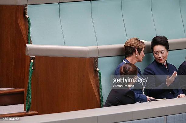Madame Peng and Margie Abbott speak prior to President Xi Jinping's address to the Australian Government in the House of Representatives at...