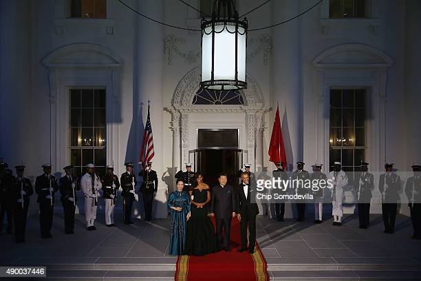 Madame Peng Liyuan US First Lady Michelle Obama Chinese President Xi Jinping and US President Barack Obama pose for photographers on the North...