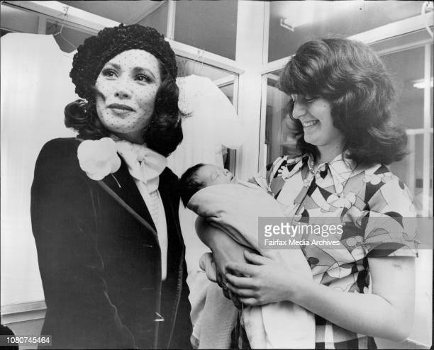 Madame Sukarno with Mrs Susan Gularti of Belfield at her Peter 2 weeks oldMadame RatnaSari Dewi Sukarno wife of the late president of Indonesia who...