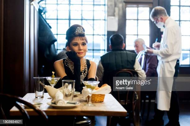 Madame Tussauds Audrey Hepburn wax figure joins diners at Peter Luger Steak House to help with social distancing amid the Coronavirus pandemic on...