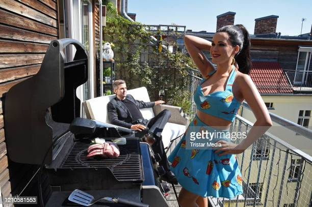 Madame Tussauds Berlin wax figures of US singer Katy Perry and US actor George Clooney are relocated and rearranged in a domestic quarantine...
