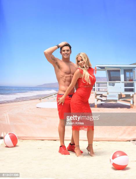 "Madame Tussauds Hollywood unveils new Zac Efron ""Baywatch"" wax figure with Carmen Electra and the men of Australia's Thunder from Down Under at..."