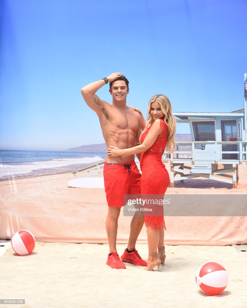 Madame Tussauds Hollywood unveils new Zac Efron 'Baywatch' wax figure with Carmen Electra and the men of Australia's Thunder from Down Under at Madame Tussauds on July 12, 2017 in Hollywood, California.