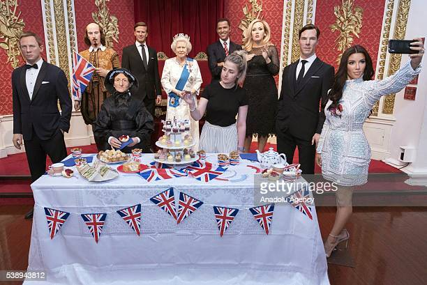 Madame Tussauds London marks Britain's Queen Elizabeth II 90th birthday with a star studded street party including waxworks of Daniel Craig William...