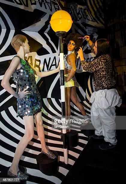 Madame Tussauds London Studio Artist Gemma Sim styles the hair of a wax model of Marsha Hunt in an iconic swinging sixties scene as part of regular...