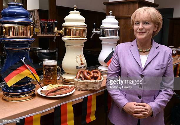 Madame Tussauds London take their Angela Merkel wax figure to German bar Bierschenke to celebrate her 60th birthday and the German World Cup Win on...
