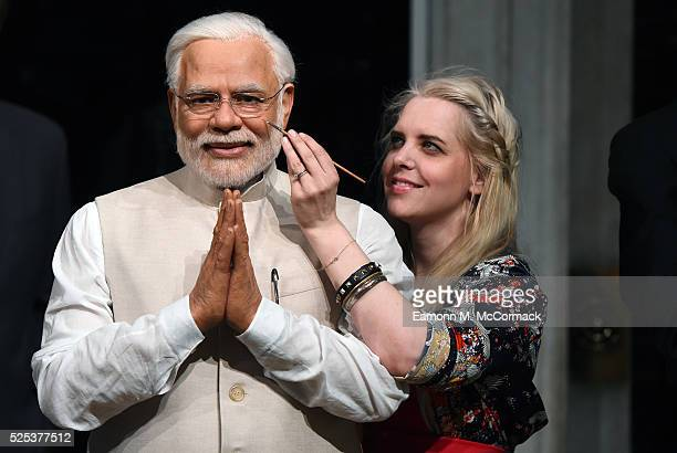Madame Tussauds studio artist puts the finishing touches on new wax figure of Narendra Modi, Prime Minister of India as it joins World leaders...