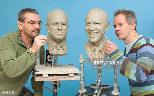 Madame Tussauds' studio artists Les Punter and Jim Kempton work on clay head moulds of presidential candidates Senator John McCain and Senator Barack...