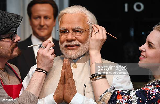 Madame Tussauds studio artists put the finishing touches on new wax figure of Narendra Modi, Prime Minister of India as it joins World leaders...
