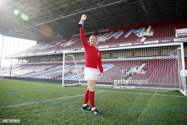 Madame Tussauds unveil a new wax figure of 1966 England Captain Bobby Moore on May 19 2014 at West Ham United's Boelyn Ground London England