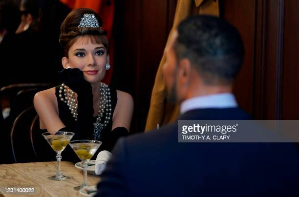 """Madame Tussauds wax figures of actress Audrey Hepburn who plays Holly Golightly in the movie """"Breakfast at Tiffany's"""" and Michael Anthony Strahan,..."""