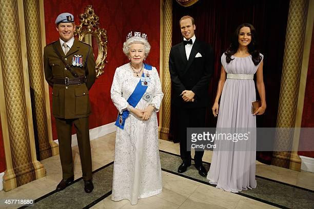Madame Tussauds wax figures of Prince Harry Queen Elizabeth II Prince William Duke of Cambridge and Catherine Duchess of Cambridge on display as wax...