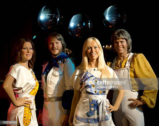 Madame Tussauds waxwork models of Swedish pop group Abba are displayed at a roller disco in the Renaissance Room in London on October 2 2012 The wax...