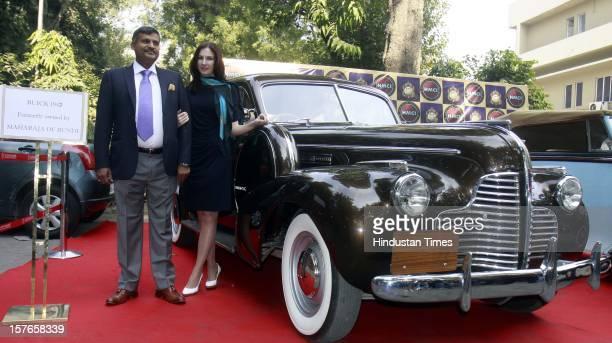 Madan Mohan Managing Director 21 Gun Salute with a model unveiling the Maharaja of Mysore Buick 1940 and marques of bygone era vintage cars Bentley...