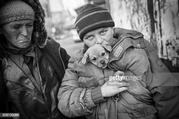 Maddalena Ilie with her dog and her mother 38 yearold Flori Ilie Both are homeless and addicted to huffing Aurolac paint They survive by begging for...