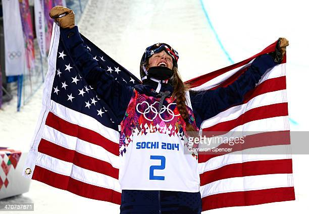 Maddie Bowman of the United States celebrates winning the gold medal in the Freestyle Skiing Ladies' Ski Halfpipe Finals on day thirteen of the 2014...