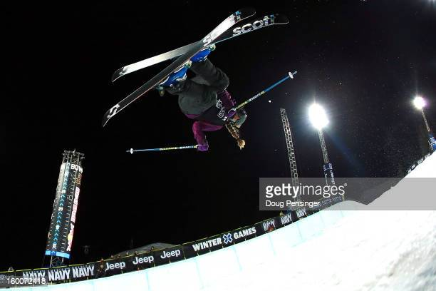 Maddie Bowman of the USA spins above the pipe to win the gold medal in the Women's Ski Superpipe Finals at Winter X Games Aspen 2013 at Buttermilk...