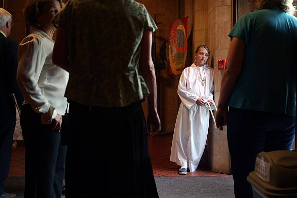 Minneapolis interfaith memorial service honors bridge victims photos maddie brown a church acolyte helps to greet people as they arrive for an m4hsunfo