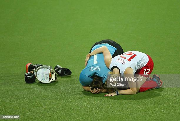 Maddie Hinch and Hollie Webb of England look dejected after losing the penalty shoot out to Australia during the Women's Gold Medal Final match...