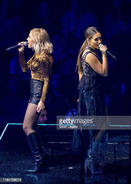 Maddie Marlow and Tae Dye of Maddie Tae perform onstage at Little Caesars Arena on October 31 2019 in Detroit Michigan