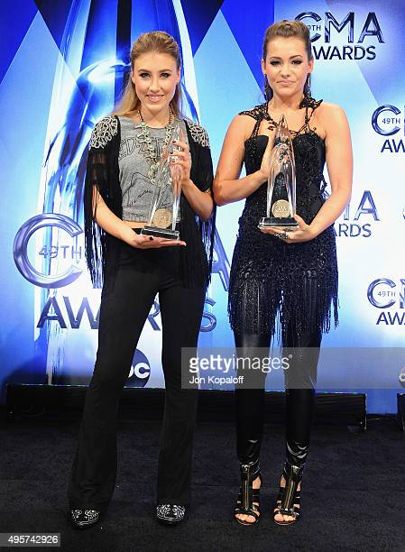 Maddie Marlow and Tae Dye of Maddie Tae pose in the press room at the 49th annual CMA Awards at the Bridgestone Arena on November 4 2015 in Nashville...