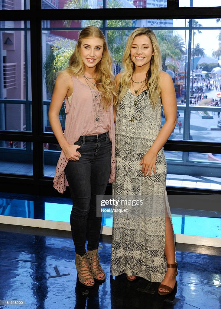 Maddie Marlow (L) and Tae Dye of Maddie & Tae visit 'Extra' at Universal Studios Hollywood on August 19, 2015 in Universal City, California.