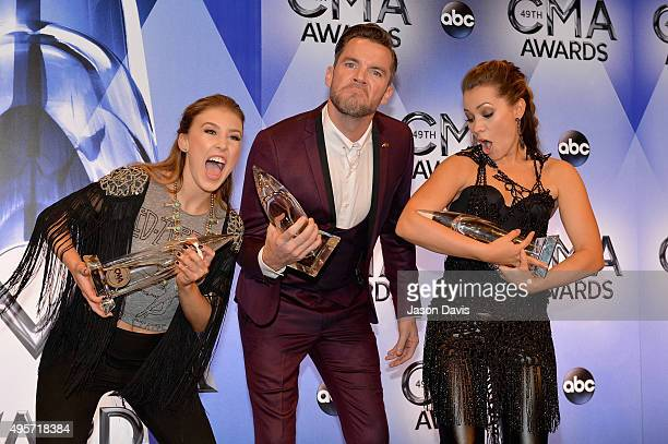 Maddie Marlow and Tae Dye of musical duo Maddie Tae and director TK McKamy pose with their Video of the Year awards during the 49th annual CMA Awards...