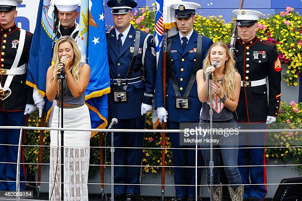 Maddie Marlow and Tae Dye perform before the Brickyard 400 at the Indianapolis Motor Speedway on July 26 2015 in Indianapolis Indiana