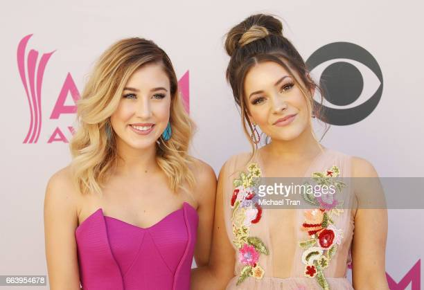 Maddie Marlow and Taylor 'Tae' Dye of music group Maddie Tae arrive at the 52nd Academy of Country Music Awards held at TMobile Arena on April 2 2017...