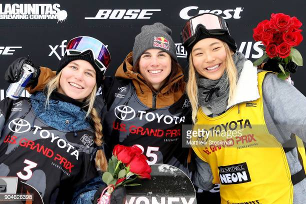 Maddie Mastro Queralt Castellet of Spain and Chloe Kim pose for photographers on the medals podium after the Ladies Snowboard Halfpipe final during...