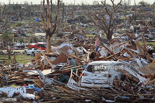 Maddie Meek and her mother Dina Meek salvage what they can from her sister-in-law's home after it was destroyed when massive tornado passed through...