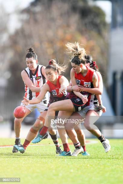 Maddie Shevlin of the Casey Demons is tackled as she kicks the ball during the VFL Women's round 9 game between the Casey Demons and Southern Saints...