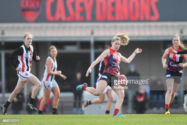 Maddie Shevlin of the Casey Demons kicks the ball during the VFL Women's round 9 game between the Casey Demons and Southern Saints at Casey Fields in...