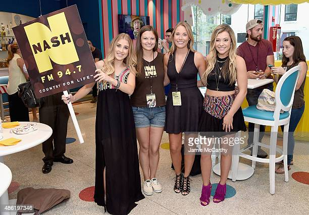 Maddie Tae pose with fans at the Maddie Tae Album Release Party at Dylan's Candy Bar on September 1 2015 in New York City