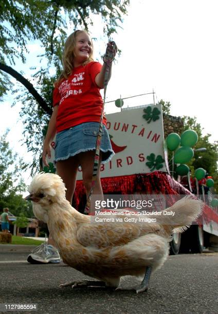Maddie Uilk 10 walks her Polish chicken They are part of the 4H Rocky Mountain SnowbirdsThe Boulder County Fair Parade was held Saturday in Longmont...