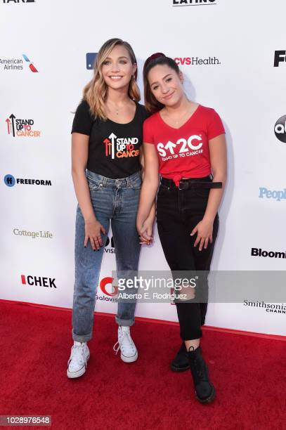 Maddie Ziegler and Mackenzie Ziegler attend the sixth biennial Stand Up To Cancer telecast at the Barkar Hangar on Friday September 7 2018 in Santa...