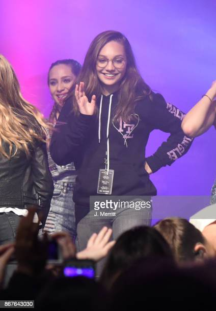 Maddie Ziegler is seen celebrating on stage after Johnny Orlando Mackenzie Ziegler perform during their 'Day NIght' tour at Mr Smalls on October 28...