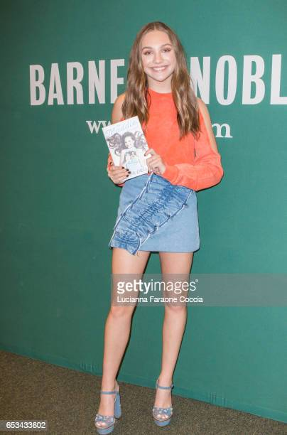 Maddie Ziegler poses for photos at the signing of her book The Maddie Diaries at Barnes Noble at The Grove on March 14 2017 in Los Angeles California