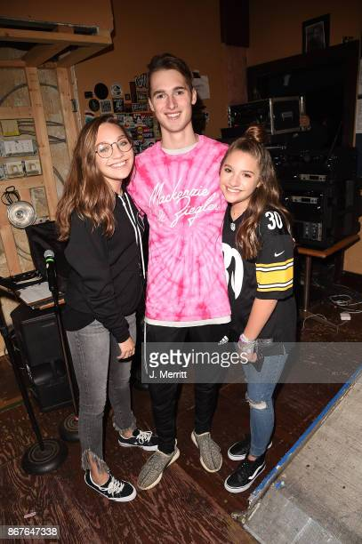 Maddie Ziegler Ryan Ziegler and Mackenzie Ziegler pose backstage during the 'Day NIght' tour at Mr Smalls on October 28 2017 in Millvale Pennsylvania