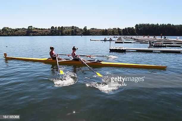 Maddison Hocking and Alice Pallister of Howick College girls U18 novice double leave the start pontoon in the D final during day four of the Maadi...
