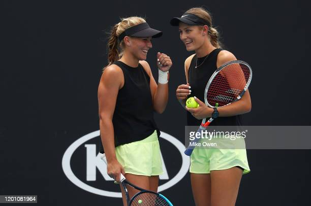 Maddison Inglis and Kaylah McPhee of Australia talk tactics during their Women's Doubles first round match against Lyudmyla Kichenok of Ukraine and...