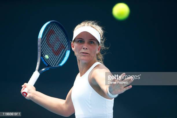 Maddison Inglis of Australia plays a forehand in her match against Rebecca Sramkova of Slovakia during 2020 Australian Open Qualifying at Melbourne...