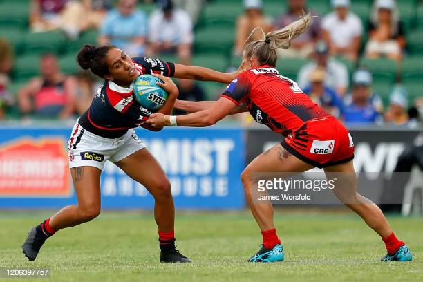 Maddison Studdon of the Dragons tackles down Ash Quinlan of the Roosters during the match between the Dragons and Roosters from Day 2 of the 2020 NRL...