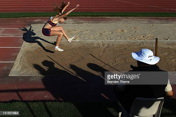 Maddison Walton of QLD competes in the U15 Womens Triple Jump during day five of the Australian Junior Championships at Sydney Olympic Park Athletic...