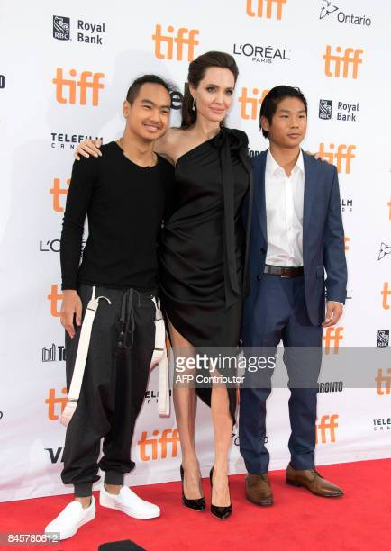 Maddox Chivan JoliePitt Angelina Jolie and Pax Thien JoliePitt attend the premiere of 'First they Killed my Father' at the Toronto International Film...
